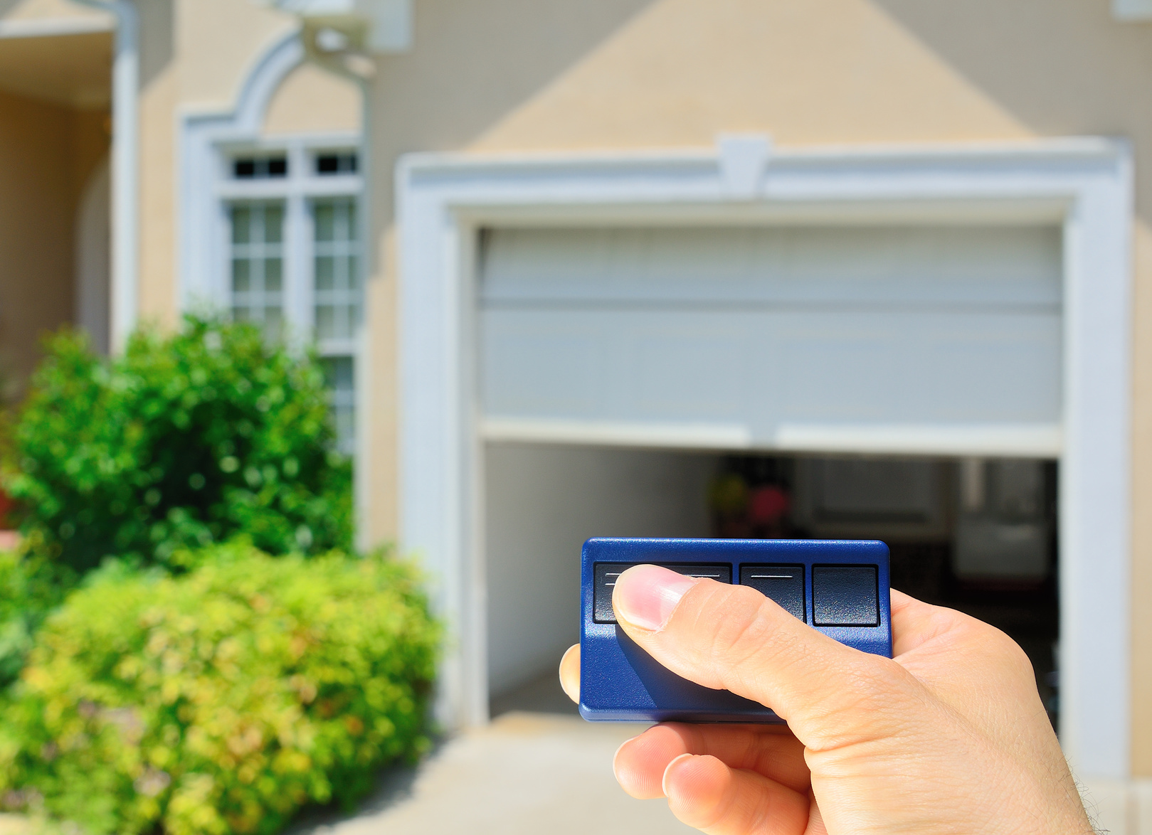 garage door opener opening a residential garage door