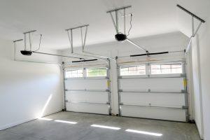 Interior view of 2 car residential garage with garage door openers