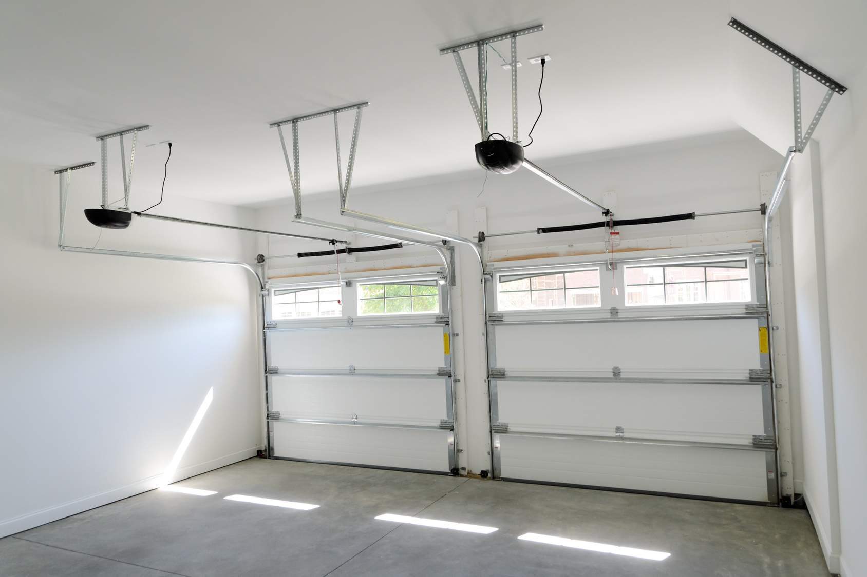 Interior View Of 2 Car Residential Garage With Door Openers