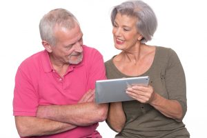 Senior couple looking at Ipad