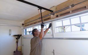 Garage Door Repair Service Technician repairing garage door