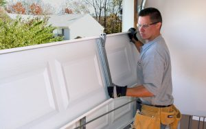 Garage Door Service Technician working with Clopay Garage Door