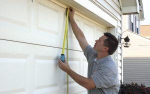 Affordable Garage Door's expert technician installs a Clopay garage door