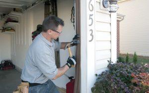 Garage Door Repair Technician Repairing Rails