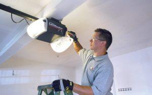 Garage Door Service technician repairing a garage door opener
