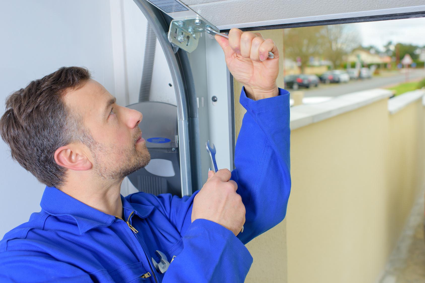 Garage Door Repair Technician repairing garage door rails  sc 1 st  Affordable Garage Door & Dyer Garage Door Rails   Affordable Garage Door   Garage Door Repair ...