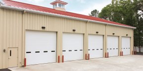 row of garages for skilled pole barn door company in shelby