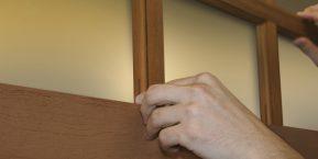 worker fixing garage door image for reliable garage door repair service in demotte