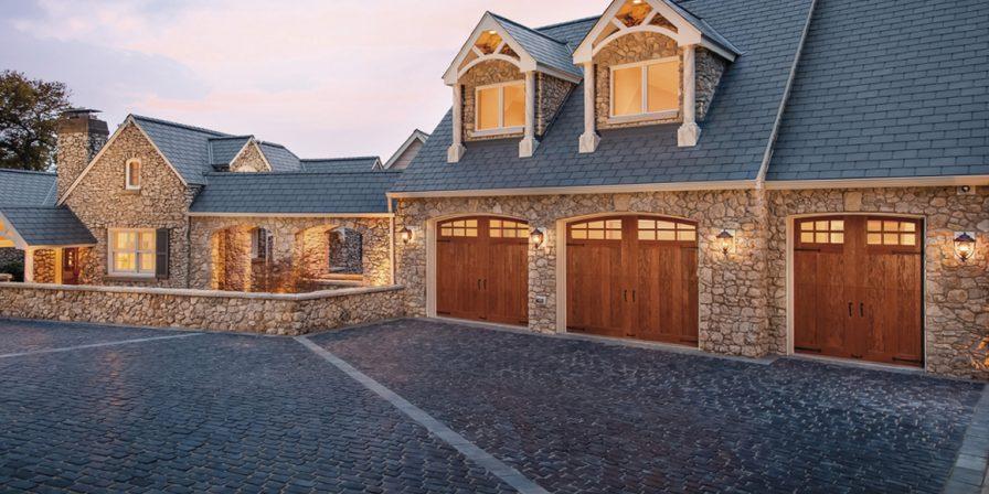 brick driveway with wooden garage doors image for reputable garage door maintenance company in kouts