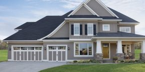 new home with three car garage if looking for reputable garage door company with showroom in Merrillville