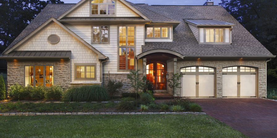 home with attached two car garage for garage door repair service in crown point