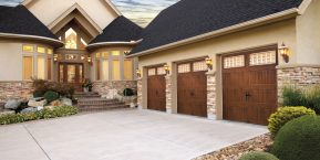 three car garage image if looking up a rated garage door company for installation in Lowell