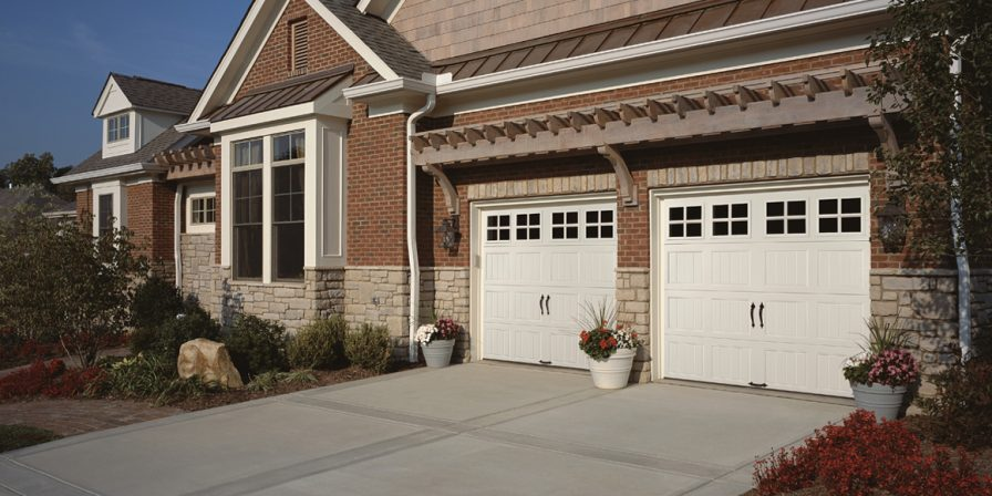 white garage doors if needing to fix a broken spring a skilled garage company in Dyer is what you need