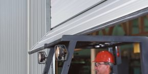 worker driving under garage door when needing an experienced repairman to fix your garage door look to Cedar Lake garage door company