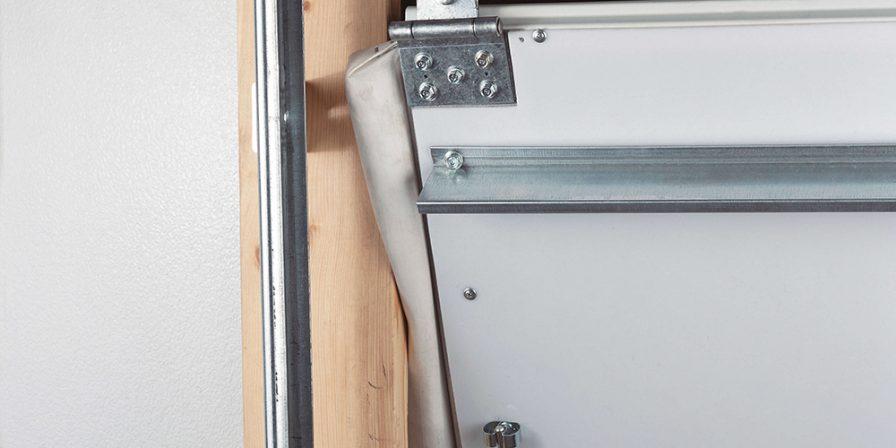 inside of garage door detail when needing help fixing garage door that has come offtrack call Cedar Lake garage door repair company for help