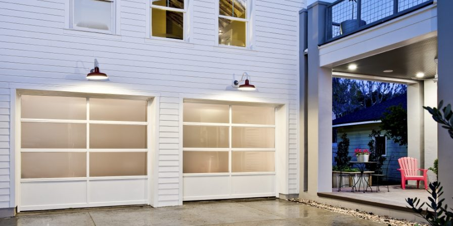 custom windowed garage doors in researching modern trends for garage doors for your new home contact a reputable Merrillville garage door installation company