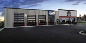 store front with garage door concept for your business's new garage door installation contact Lowell garage door company with professional installers