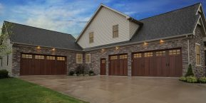 driveway leading to home with expansive garages image for garage door replacement company in griffith